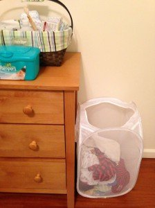 Hamper next to changing table