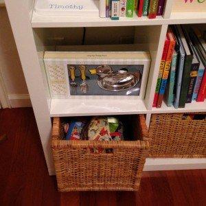 baskets under bookshelves